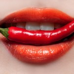 Woman lips and chili pepper