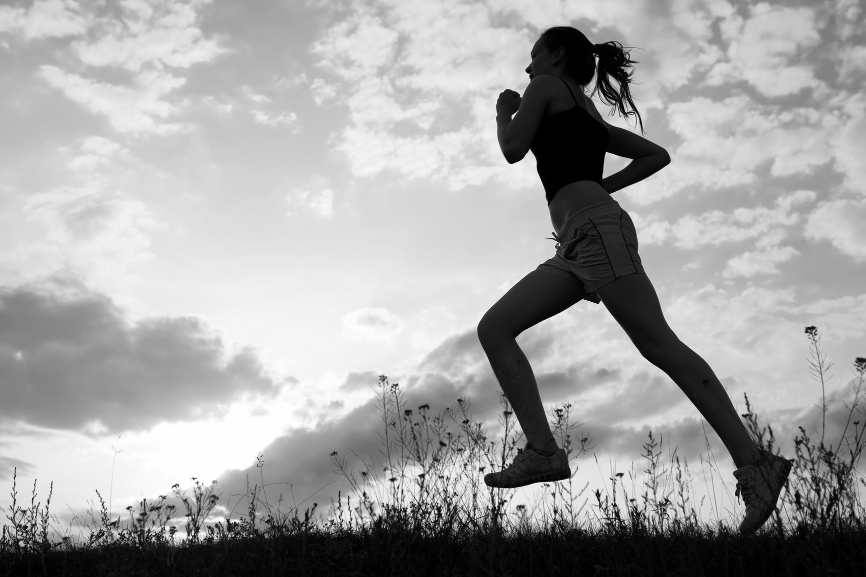 Silhouette woman run under blue sky