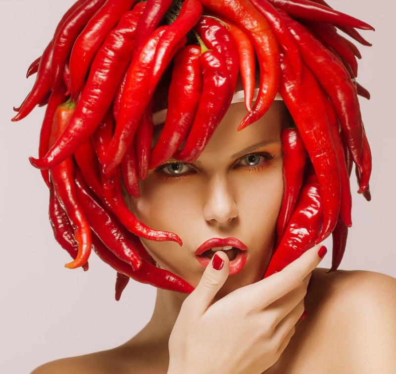 19025446 - glamour  hot chili pepper on shiny woman