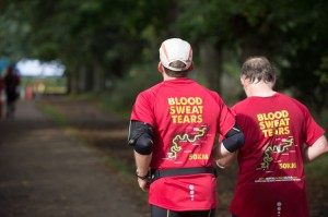 Two_men_running_together_wearing_their_Blood__Sweat_and_Tears_t-shirts