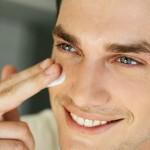 Man applying moisturizer