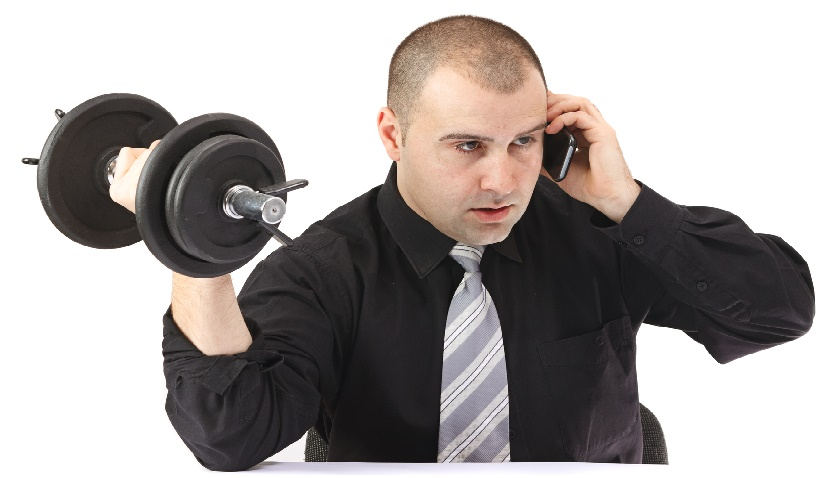 Adult business man on the phone doing fitness at work