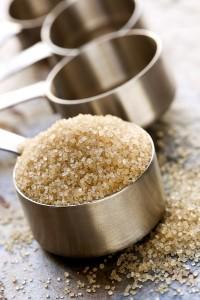 Raw Sugar in Measuring Spoon