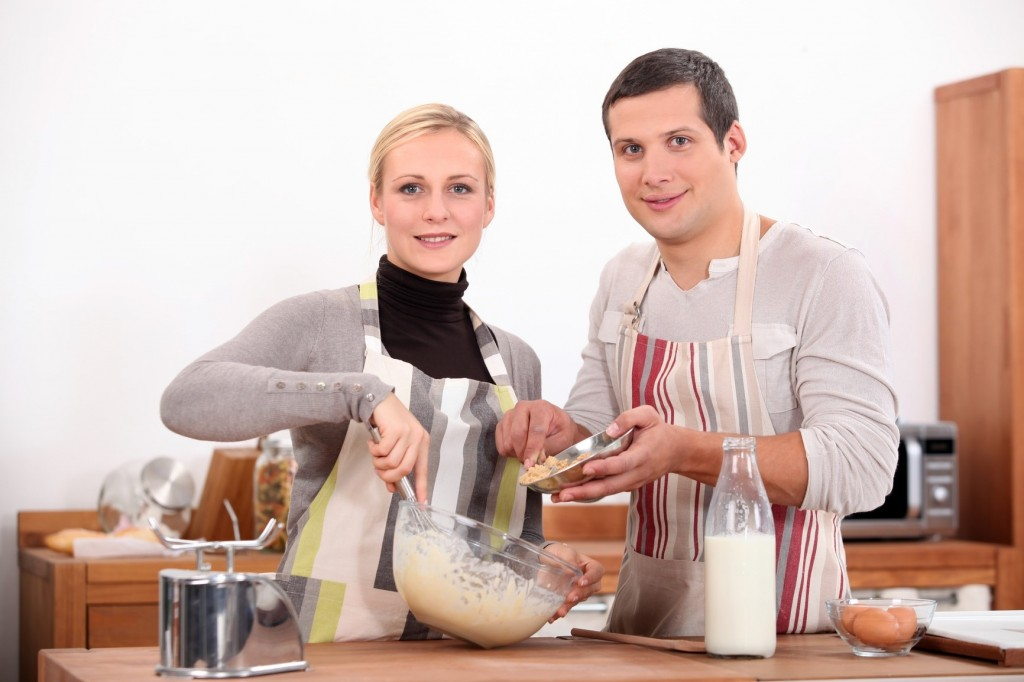 Couple baking in kitchen