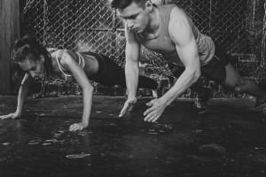 Sportsmen. fit male trainer man and woman doing clapping push-up